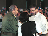 "Sinn Fein leader Gerry Adams (R) talks with Cuban President Fidel Castro during , an official act in the School ""Carlos de La  Torre"", today in Havana, Cuba, Monday, Dec.17, 2001.  Credit: Jorge Rey/MediaPunch"