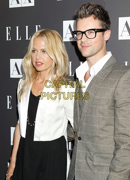 "RACHEL ZOE & BRAD GORESKI.Armani Exchange and ELLE Present ""Disco Glam"" With A Performance By Dragonette held at the A/X Robertson Store, Los Angeles, CA, USA..May 25th, 2010.half length black dress white jacket grey gray glasses check.CAP/ADM/MJ.©Michael Jade/AdMedia/Capital Pictures."