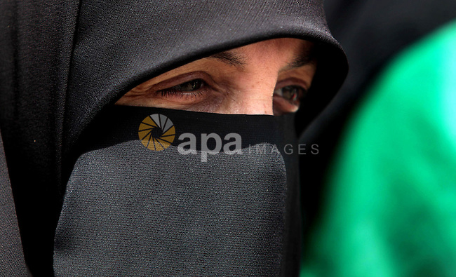 A Palestinian woman takes part in a protest to support the Palestinian parliament, Aziz Dweik, in front of the Legislative Council in Gaza City on June 19, 2014. Israeli forces raided Hebron and detained speaker of the Palestinian parliament, Aziz Dweik, along with five other parliamentarians during in an operation to locate three Israeli teens in the West Bank. Photo by Ashraf Amra