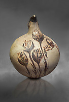 Beak spouted jug decorated with flowering crocus. Early Cycladic I (1650-1550 BC) , Phylakopi, Melos. National Archaeological Museum Athens. Cat No 5769.  Gray background.<br /> <br /> <br /> During this Cycladic period the pottery designs were heavily influenced by Cretean minoan with pottery like this using floral patterns.