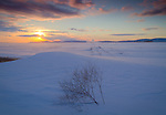 Idaho, North, Rathdrum. Sunset on the Rathdrum Prarie over snow covered fields in winter.