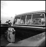 1997-A gas can sits in the back of a pickup truck at the Airboat Club on Tamiami Trail in the Florida Everglades. The Florida Everglades are a disappearing world. Overpopulation, the sugar and cattle industry, mismanagement of the land, droughts and bush fires are just a few of the problems the Florida Everglades are facing. Here Glen Wilsey driving his airboat. According to Glen the best thing about being a tour guide in the everglades is driving the airboats. Riding an airboat is fun but driving an airboat is an awesome feeling.