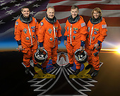 Attired in training versions of their shuttle launch and entry suits, these four astronauts take a break from training to pose for the STS-135 crew portrait in Houston, Texas on February 11, 2011. Pictured are NASA astronauts Chris Ferguson, center right, commander; Doug Hurley, center left, pilot; Rex Walheim, left, and Sandy Magnus, right,mission specialists. .Mandatory Credit: Robert Markowitz - NASA via CNP