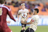 Houston, TX - Friday December 9, 2016: Jacori Hayes (8) of the Wake Forest Demon Deacons gains control of a loose ball against the Denver Pioneers at the NCAA Men's Soccer Semifinals at BBVA Compass Stadium in Houston Texas.