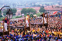 Gubbio 15 MAY 1998..Festival of the Ceri..The raising, ?Alzata? of the Ceri  the morning..the pitchers throw her among the crowd..http://www.ceri.it/ceri_eng/index.htm..