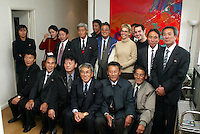 MEMEBERS OF THE NORTH KOREAN WORLD CUP TEAM OF 1966 POSE IN THE OFFICE3S OF THE FILM COMPANY THAT MADE THE FILM: THE GREATEST GAME OF THEIR LIFE WITH FILM DIRECTOR DANIEL GORDON (2ND ROW 3RD FROM RIGHT AND FILM EDITIOR JUSTINE WRIGHT NEXT TO HIM~)- PICTURE  BY MARCELLO POZZETTI FOR THE TIMES NEWSPAPERS- MARCELLO POZZETTI 21 DELISLE ROAD LONDON SE28 0JD=TEL 02088551008 - FAX: 02088551937 - MOBILE 07973308835