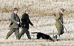 ©Albanpix.com_Picture by Alban Donohoe.The Duke of Edinburgh out shooting on the Sandringham Est, Norfolk today 5/1/08.The Duke wipes his nose on his sleeve  has his black lab gun dog is kept on a  lead by his head game keeper