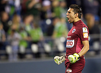 CF Monterrey goalkeeper Jonathan Orozco celebrates a goal by Darío Carreño during a CONCACAF Champions League match against the Seattle Sounders FC at CenturyLink Field in Seattle Tuesday Oct. 18, 2011. CF Monterrey won the game 2-1. Orozco was later injured.
