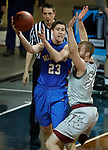 SIOUX FALLS, SD - MARCH 9:  Jackson Lamb #23 of Briar Cliff passes around IU East defender Lucas Huffman #32 at the 2018 NAIA DII Men's Basketball Championship at the Sanford Pentagon in Sioux Falls. (Photo by Dick Carlson/Inertia)