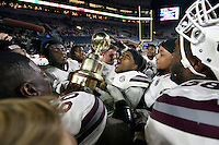 Mississippi State University football players celebrate after defeating the University of Mississippi 55-20 in Saturday's [Nov. 26] Egg Bowl in Oxford.<br />