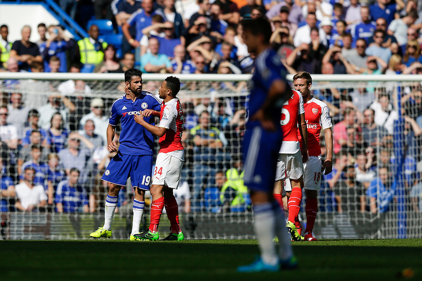 Arsenal's Francis Coquelin gets to grips with Chelsea's Diego Costa <br /> <br /> Photographer Craig Mercer/CameraSport<br /> <br /> Football - Barclays Premiership - Chelsea v Arsenal - Saturday 19th September 2015 - Stamford Bridge - London<br /> <br /> &copy; CameraSport - 43 Linden Ave. Countesthorpe. Leicester. England. LE8 5PG - Tel: +44 (0) 116 277 4147 - admin@camerasport.com - www.camerasport.com