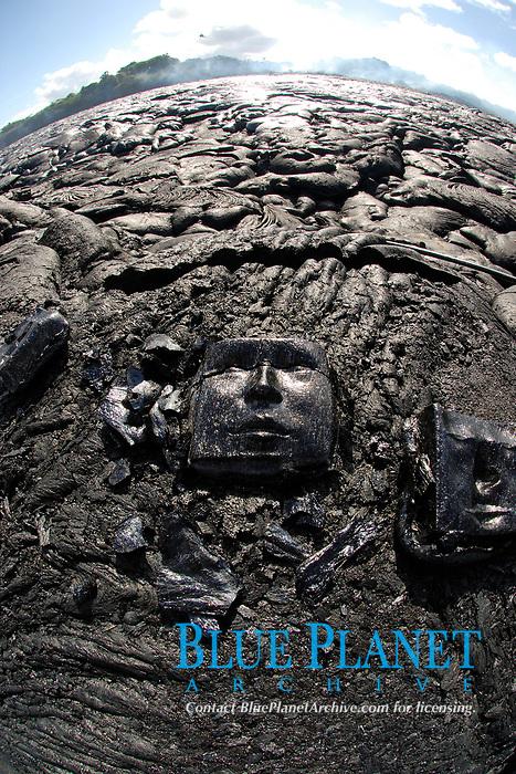 Man creates lava art with cast iron molds, Waikupanaha ocean entry lava flow area, East of Hawaii, USA Volcanoes National Park, Kalapana, Hawaii, USA, The Big Island of Hawaii, USA