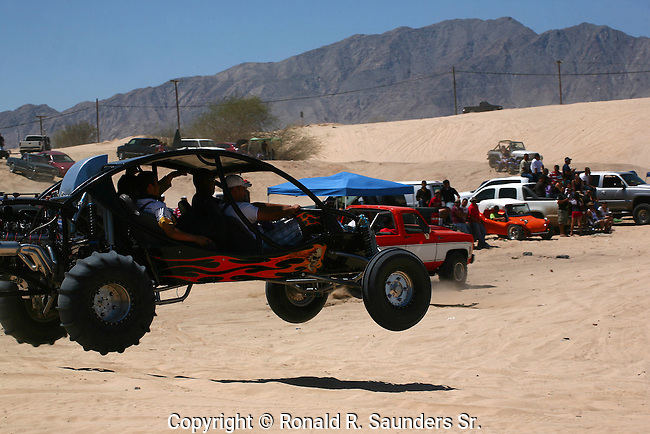 ATV VECHICLE COMPETES in OFF ROAD <br /> RACE WITH ALL WHEELS OFF the SAND<br /> (21)