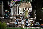 An entertainer makes giant bubbles for children inside Inokashira Park in the trendy neighborhood of Kichijoji in Musashino City, Tokyo, Japan on 16 Sept. 2012.  Photographer: Robert Gilhooly