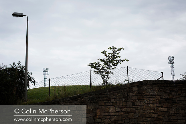 An interior view ground showing two floodlights at Meadowbank Stadium in Edinburgh, before Edinburgh City played host to Spartans in a Lowland League fixture. The host won the match 1-0 with a late goal by Ousman See, despite playing for the last 30 minutes with 10 men after Ross Allum was sent off. The wind kept the reigning champions side clear at the top of the league.