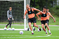 Mike van der Hoorn vies for possession with Courtney Baker-Richardson of Swansea City during the Swansea City Training Session at The Fairwood Training Ground, Wales, UK. Tuesday 11th September 2018