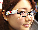 February 8, 2017, Tokyo, Japan - Japan's character giant Sanrio employee displays Sanrio's character Hello Kitty designed wearable camera Blincam at the company's latest products exhibition at Sanrio headquarters in Tokyo on Wednesday, February 8, 2017. The Blincam can attach on the eyeglasses and take pictures by blinking eye.    (Photo by Yoshio Tsunoda/AFLO) LwX -ytd-