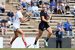 20 February 2016: Florida's Shayna Pirreca (7) and North Carolina's Stephanie Lobb (left). The University of North Carolina Tar Heels hosted the University of Florida Gators in a 2016 NCAA Division I Women's Lacrosse match. Florida won the game 16-15.