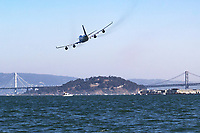 Boeing 747-400 (N121UA) makes a low pass over San Francisco Bay in October of 2017.