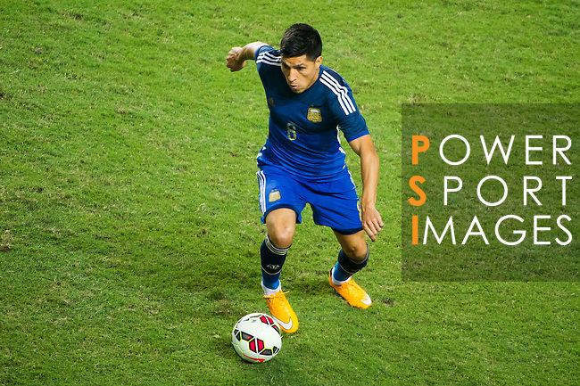 Enzo Perez of Argentina in action during the HKFA Centennial Celebration Match between Hong Kong vs Argentina at the Hong Kong Stadium on 14th October 2014 in Hong Kong, China. Photo by Chung Yan / Power Sport Images