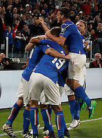 Italy Daniele De Rossi is hidden by teammates hugs after scoring the equalizer goal on a penalty kick during the Fifa World Cup 2018 qualification soccer match between Italy and Spain at Turin's Juventus Stadium, October 6, 2016. The game ended 1-1.<br /> UPDATE IMAGES PRESS/Isabella Bonotto