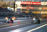 Nov 11, 2017; Pomona, CA, USA; NHRA top fuel driver Brittany Force (right) races alongside Clay Millican during qualifying for the Auto Club Finals at Auto Club Raceway at Pomona. Mandatory Credit: Mark J. Rebilas-USA TODAY Sports