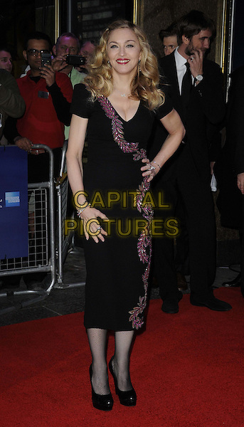 Madonna (wearing L'Wren Scott).'W.E.' UK film premiere, 55th BFI London Film Festival, Empire cinema, Leicester Square, London, England..23rd October 2011.LFF full length black dress red pink leaf leaves pattern diamante hand on hip.CAP/CAN.©Can Nguyen/Capital Pictures.