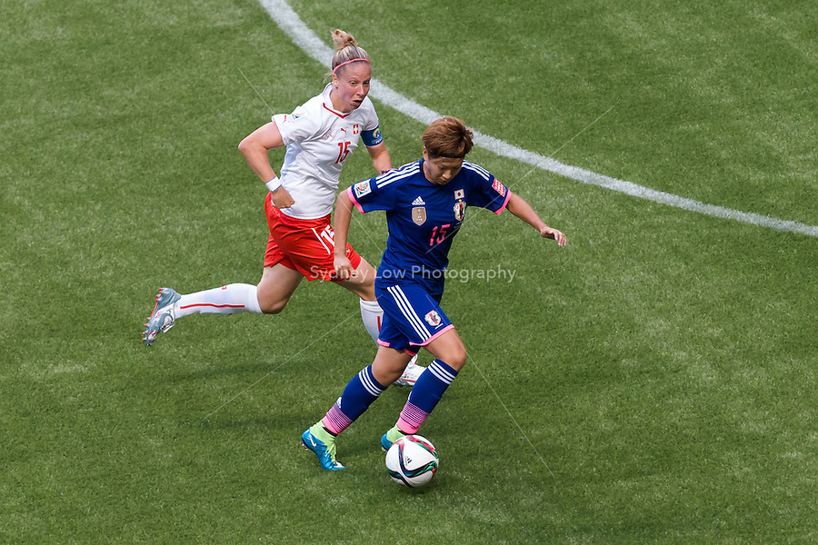 June 8, 2015: Yuika SUGASAWA of Japan controls the ball during a Group C match at the FIFA Women's World Cup Canada 2015 between Japan and Switzerland at BC Place Stadium on 8 June 2015 in Vancouver, Canada. Sydney Low/AsteriskImages