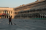 Sweeping St Marks square, Venice, Italy.