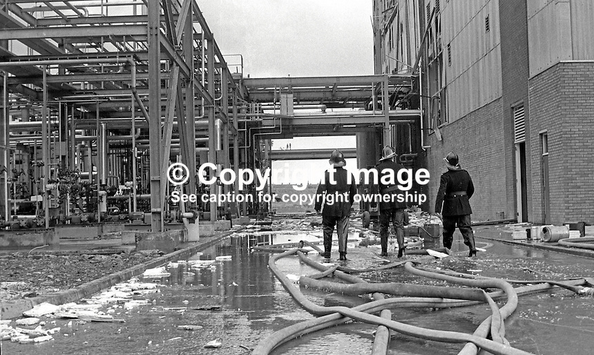 Firemen at the Courtalds plant, Carrickfergus, Co Antrim, N Ireland, following Provisional IRA bomb attack in which 1 man died and 10 were injured, some seriously. Security forces claimed inadequate warning was given to prevent loss of life. 197205010202c.<br /> <br /> Copyright Image from Victor Patterson, 54 Dorchester Park, Belfast, UK, BT9 6RJ<br /> <br /> t1: +44 28 9066 1296 (from Rep of Ireland 048 9066 1296)<br /> t2: +44 28 9002 2446 (from Rep of Ireland 048 9002 2446)<br /> m: +44 7802 353836<br /> <br /> e1: victorpatterson@me.com<br /> e2: victorpatterson@gmail.com<br /> <br /> www.victorpatterson.com<br /> <br /> IMPORTANT: Please see my Terms and Conditions of Use at www.victorpatterson.com