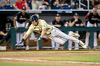 Vanderbilt Commodores outfielder JJ Bleday (51) slides home with the game tying run against the Louisville Cardinals in the NCAA College World Series on June 21, 2019 at TD Ameritrade Park in Omaha, Nebraska. Vanderbilt defeated Louisville 3-2 to head to the CWS Finals. (Andrew Woolley/Four Seam Images)