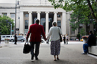 A member of the Class of 1962 walks holding hands with his wife toward Building 7 wearing his 50th anniversary red coat before the 2012 MIT Commencement on June 8, 2012, in Cambridge, Massachusetts, USA...Photo by M. Scott Brauer