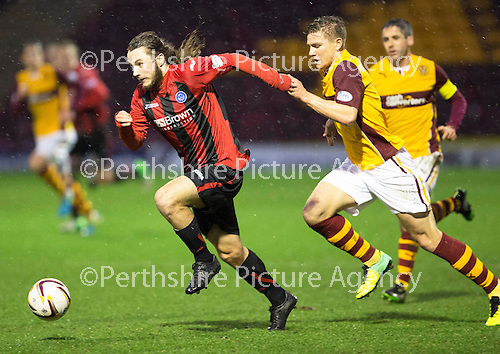 Motherwell v St Johnstone.....01.01.14   SPFL<br /> Stevie May gets away from Shaun Hutchison to get a shot at goal<br /> Picture by Graeme Hart.<br /> Copyright Perthshire Picture Agency<br /> Tel: 01738 623350  Mobile: 07990 594431