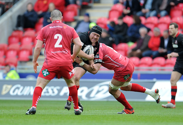 Edinburgh's WP Nel is tackled by Scarlets' George Earle<br /> <br /> Photographer Ian Cook/CameraSport<br /> <br /> Rugby Union - Guinness PRO12 - Scarlets v Edinburgh - Saturday 28th March 2015 - Parc y Scarlets - Llanelli<br /> <br /> &copy; CameraSport - 43 Linden Ave. Countesthorpe. Leicester. England. LE8 5PG - Tel: +44 (0) 116 277 4147 - admin@camerasport.com - www.camerasport.com