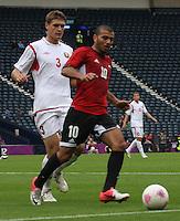 Men's Olympic Football match Egypt v Belarus on 1.8.12...Meteab Emad of Egypt and Igor Kuzmenok of Belarus, during the Men's Olympic Football match between Egypt v Belarus at Hampden Park, Glasgow.