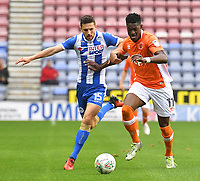 Blackpool's Armand Gnanduillet battles with Wigan Athletic's Jordan Flores<br /> <br /> Photographer Dave Howarth/CameraSport<br /> <br /> The Carabao Cup - Wigan Athletic v Blackpool - Tuesday 8th August 2017 - DW Stadium - Wigan<br />  <br /> World Copyright &copy; 2017 CameraSport. All rights reserved. 43 Linden Ave. Countesthorpe. Leicester. England. LE8 5PG - Tel: +44 (0) 116 277 4147 - admin@camerasport.com - www.camerasport.com