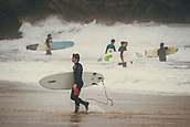 3rd January 2018,  Baleal, Peniche Portugal - Surfer comes out of the water after a practice session in January 3rd , before the upcoming Nazare big-wave surfing event which will have giant wave runs