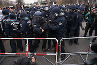 """Mehr als 3.500 Menschen protestierten am Samstag den 22. November 2014 in Berlin Marzahn-Hellersdorf gegen einen Aufmarsch von ca. 550 Neonazis, Hooligans, NPD-Mitgliedern, Mitgliedern der Neonazipartei """"Die Rechte"""", sowie einer sog. Buergerinitiative """"Gegen Asylmissbrauch den Mund aufmachen"""".<br /> Die Rechtsradikalen wollten gegen eine geplante Fluechtlingsunterkunft protestieren und durch den Stadtteil marschieren.<br /> Dagegen versammelten sich bereits Stunden vor dem Neonazi-Aufmarsch ueber 1.500 Menschen an mehreren Punkten der Marschroute an den Polizeiabsperrungen.<br /> Bis zum Einbruch der Dunkelheit konnte der rechtsradikale Aufmarsch nur ca. 70 Meter Wegstrecke zurueck legen und wurde dann von der Polizei in einer chaotischen Aktion zum S-Bahnhof gebracht. Gegendemonstranten gelang es nach unverstaendlichen Polizeimanoevern bis auf wenige Meter an die Rechtsradikalen zu gelangen und es kam zu Auseinandersetzungen bei denen beide Seiten sich mit Flaschen, Steinen und Feuerwerkskoerpern bewarfen.<br /> Im Bild: An einer Polizeiabsperrung kommt es zu einer Rangelei bei der die Polizei Festnahmen macht.<br /> 22.11.2014, Berlin<br /> Copyright: Christian-Ditsch.de<br /> [Inhaltsveraendernde Manipulation des Fotos nur nach ausdruecklicher Genehmigung des Fotografen. Vereinbarungen ueber Abtretung von Persoenlichkeitsrechten/Model Release der abgebildeten Person/Personen liegen nicht vor. NO MODEL RELEASE! Nur fuer Redaktionelle Zwecke. Don't publish without copyright Christian-Ditsch.de, Veroeffentlichung nur mit Fotografennennung, sowie gegen Honorar, MwSt. und Beleg. Konto: I N G - D i B a, IBAN DE58500105175400192269, BIC INGDDEFFXXX, Kontakt: post@christian-ditsch.de<br /> Bei der Bearbeitung der Dateiinformationen darf die Urheberkennzeichnung in den EXIF- und  IPTC-Daten nicht entfernt werden, diese sind in digitalen Medien nach §95c UrhG rechtlich geschuetzt. Der Urhebervermerk wird gemaess §13 UrhG verlangt.]"""