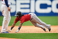 Columbus Clippers second baseman Michael Martinez (7) slides head first into third during a game against the Buffalo Bisons on July 19, 2015 at Coca-Cola Field in Buffalo, New York.  Buffalo defeated Columbus 4-3 in twelve innings.  (Mike Janes/Four Seam Images)