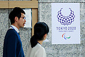 People walk past the new Tokyo 2020 Paralympic Games logo on display at the Tokyo Metropolitan building on April 27, 2016, Tokyo, Japan. After scraping the original design last year due to accusations of plagiarism; The Tokyo 2020 Logo Selection Committee settled this week on a simple indigo-and-white checkered circle design by Asao Tokolo as a new emblem for the 2020 Summer Olympic Games. The final decision was announced on Monday 25th April after the selection committee had checked through almost 15,000 design proposals. The new logos are already starting to appear on Tokyo 2020 related communications. (Photo by Rodrigo Reyes Marin/AFLO)