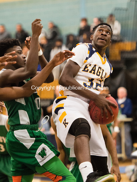 WATERBURY, CT- 13 January 2015-011316EC11-   Kennedy's Joseph Chomari grabs a rebound in front of Wilby's Ty'Quay Harding Wednesday night. Erin Covey Republican-American