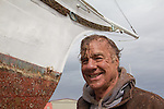 Port Townsend, Boat Haven, Christian Lee Lint, owner, Yacht, El Primero, after scouring the hull,  Jefferson County, Olympic Peninsula, Puget Sound, Washington State, Pacific Northwest, USA,