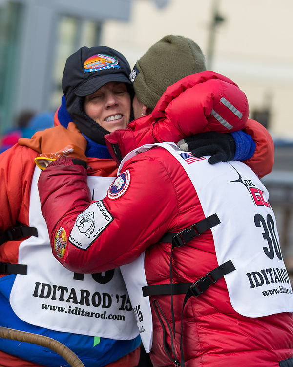 Lance Mackey hugs Cindy Abbott on her way to the starting line at the ceremenial start of the 43rd Annual Iditarod in Anchorage, Alaska. The 1000 mile dog sled race usually restarts in Willow, Alaska, and finishes in Nome. Poor snowfall, however, forced the restart north to Fairbanks.