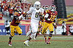 Oregon Ducks quarterback Marcus Mariota sprints past USC Trojans  defenders in the first half..Photo by Jaime Valdez