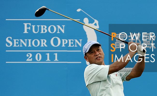 TAIPEI, TAIWAN - NOVEMBER 19:  Liang Kuo I of Taiwan tees off on the 10th hole during day two of the Fubon Senior Open at Miramar Golf & Country Club on November 19, 2011 in Taipei, Taiwan. Photo by Victor Fraile / The Power of Sport Images