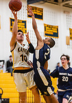 WATERBURY, CT. 09 January 2020-010920BS204 - Kaynor Tech's Fernando Cerda (10) drives to the basket against \Wolcott Tech's Anthony Petersen (2), during a Boy Basketball game between Wolcott Tech and Kaynor Tech at Kaynor Tech in Waterbury on Thursday. Bill Shettle Republican-American