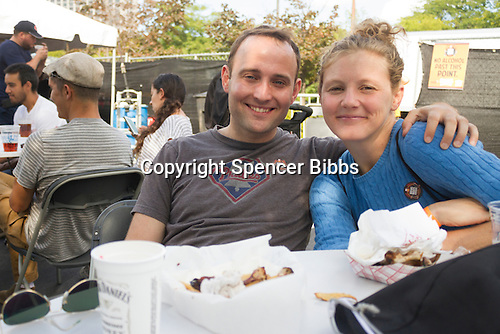 Hyde Park celebrated its first Brews, Brats and Brass Festival this weekend in the parking lot behind the Hyde Park Bank building located at 1525 E. 53rd Street. There was live music, food and beer.<br /> <br /> 5089 - Alex Lovallo and Katie Kearns enjoy Saturday afternoon.<br /> <br /> Please 'Like' &quot;Spencer Bibbs Photography&quot; on Facebook.<br /> <br /> All rights to this photo are owned by Spencer Bibbs of Spencer Bibbs Photography and may only be used in any way shape or form, whole or in part with written permission by the owner of the photo, Spencer Bibbs.<br /> <br /> For all of your photography needs, please contact Spencer Bibbs at 773-895-4744. I can also be reached in the following ways:<br /> <br /> Website &ndash; www.spbdigitalconcepts.photoshelter.com<br /> <br /> Text - Text &ldquo;Spencer Bibbs&rdquo; to 72727<br /> <br /> Email &ndash; spencerbibbsphotography@yahoo.com