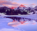 USA, California, Sierra Nevada Mountains.   Mt Dana at sunset reflecting in a partially frozen lake. Credit as: Christopher Talbot Frank