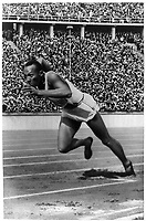"""Jesse Owens at start of record breaking 200 meter race.""<br /> <br /> This record contains unverified, old data from caption card.<br /> Olympic Games (11th : 1936 : Berlin, Germany)"