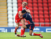 PICTURE BY VAUGHN RIDLEY/SWPIX.COM...Rugby League - International Friendly - England Knights v France - Leigh Sports Village, Leigh, England - 15/10/11…England's Ben Westwood is tackled by France's Maxime Greseque.